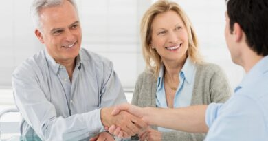 People shaking hands with a financial planner