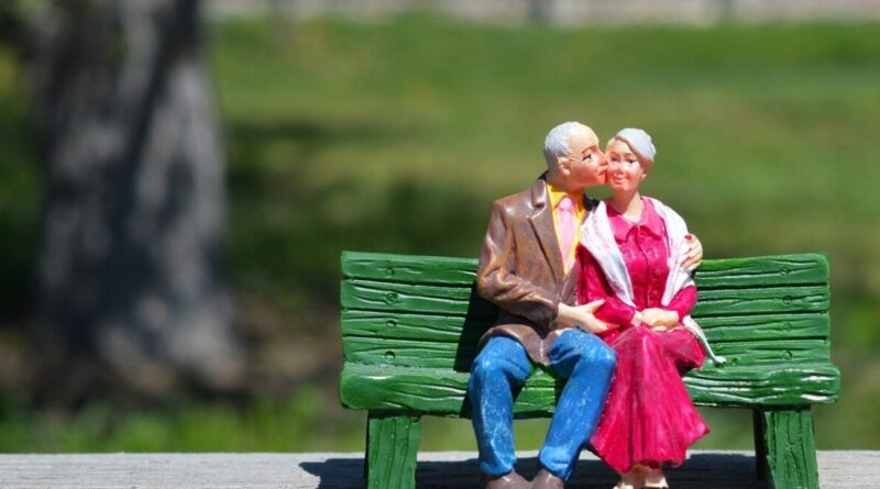A miniature of a couple on a bench