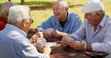 senior men playing cards