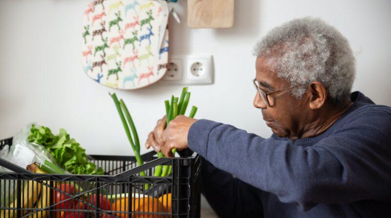 senior man with grocery basket