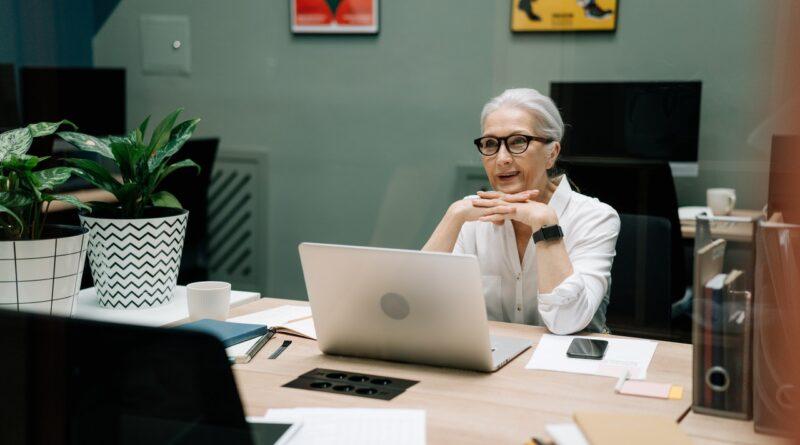 older woman at desk