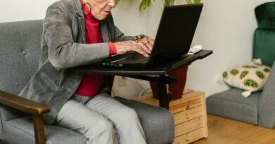 older woman using laptop