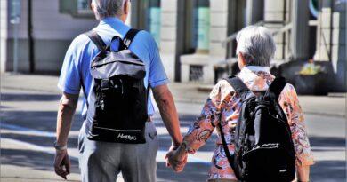 older couple wearing backpacks