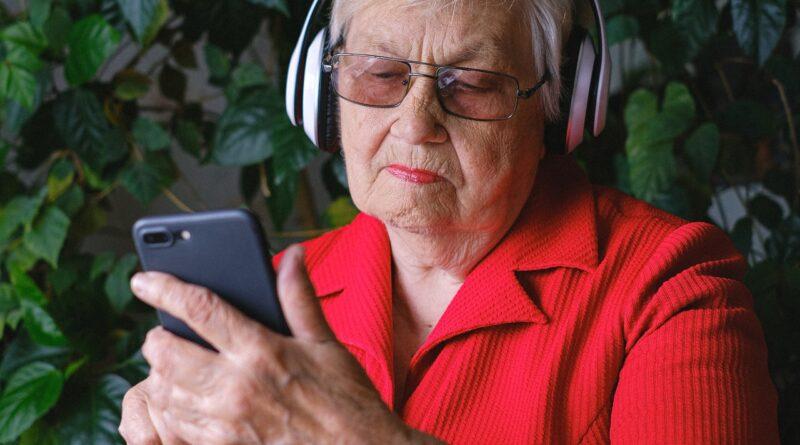 senior woman wearing headphones