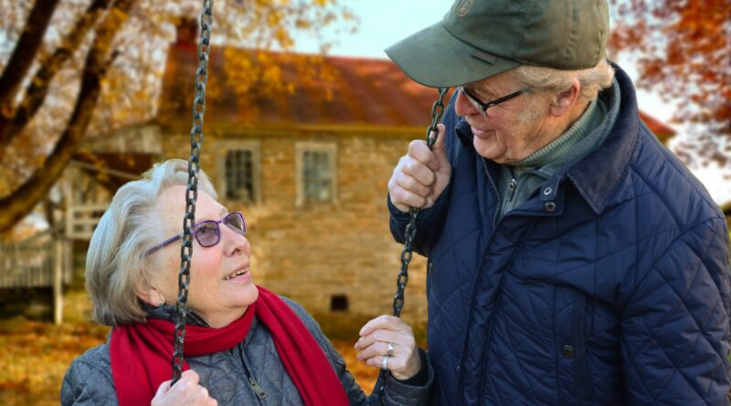 senior couple on swing
