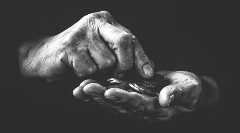 old hands with coins