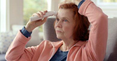 senior woman taking temperature